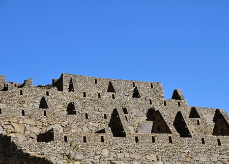 Ruined Houses at the Machu Picchu Lost City with Bright Blue Sky in the Background photo