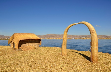 house float on water: House and Arch Made of Reed on Uros Floating Island on Highest Navigable Lake in the World -  Titicaca