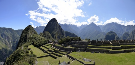 unesco world cultural heritage: Panorama of Terraces Machu Pichu with Huayna Picchu in Peru, rainforest jungle and mountains with blue sky in the background