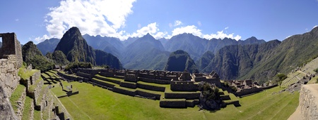 unesco world cultural heritage: Panorama of Machu Pichu with Huayna Picchu in Peru, rainforest jungle and mountains with blue sky in the background