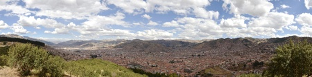 cuzco: Stitched Panorama of Cuzco City from Viewpoint from Sacsayhuaman Ruins with blue cloudy sky.