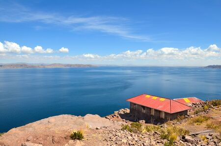 House on Taquile Island overlooking lake Titicata. Highest Navigable Lake in the world Stock Photo - 10988223