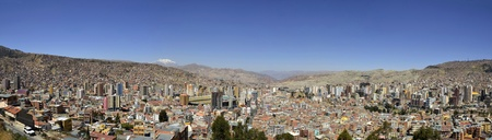 overpopulated: Panorama of City of La Paz Bolivia from Killi Killi Viewpoint. View of overpopulated crowded city slums with commercial district in the middle Stock Photo