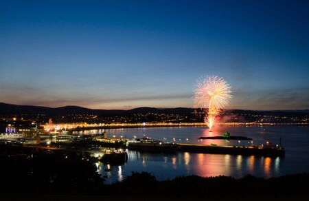 Fireworks at Douglas Bay on the  Isle of Man with reflection on the Irish Sea and Douglas City. View from Douglas Head Stock Photo - 11690617