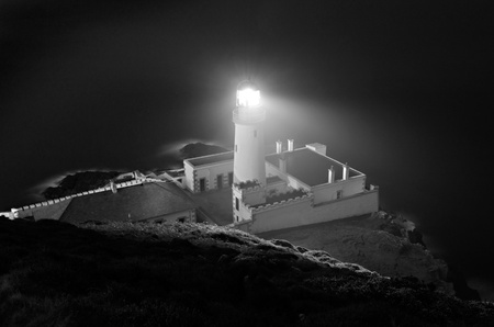Spooky Douglas Head Lighthouse at Night on the Isle of Man. Black and White photo with Long exposure effect photo