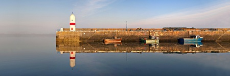Panorama of Lighthouse, Harbour, Boats with Sea and Water Reflection in Port st. Mary on the Isle of Man photo