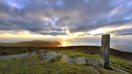 Panorama - South of the Isle of Man with Celtic Cross in the Foreground Stock Photo - 12411377