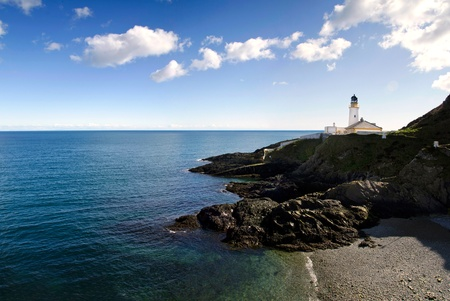 Lighthouse on Cliffs with Beach and sea on a sunny day. Douglas - Isle of Man photo