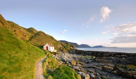 inlet bay: Path to the White Fishermans Cottage on a coast - Niarbyl on the Isle of Man Stock Photo