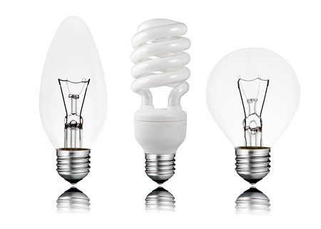 Three Lightbulbs - Saver, Candle & Golf Ball Shape with Screw Bottom and Reflection Isolated on White Background. Switched OFF photo