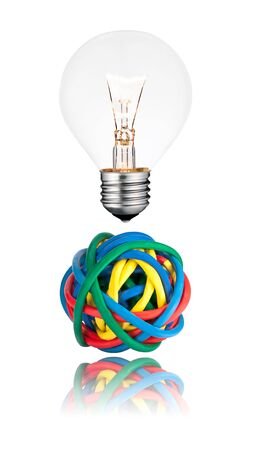 Problem Solution - Lightbulb with Ball of colored cables with reflection isolated on white background. Stock Photo - 13241118