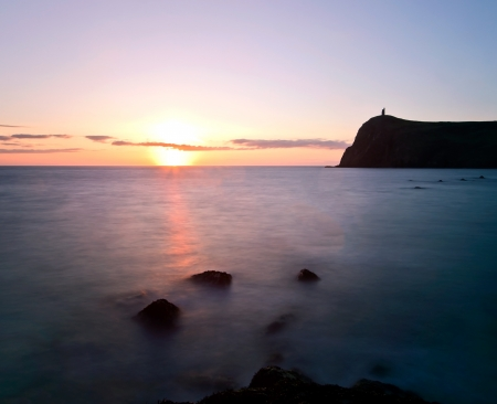 View of Brada Tower during Sunset at Port Erin on the Isle of Man - Long exposure shot photo