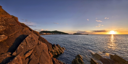 Panorama of Peel Castle and sea during sunset. Location - Isle of Man photo