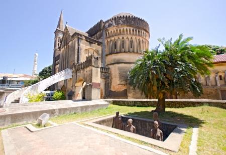 Slave Market Memorial with Church in the Background in Stone Town on Zanzibar Island - Tanzania 스톡 콘텐츠