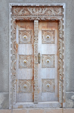 stone carving: Typical Old Wooden door in Stone Town - Zanzibar  Island in Tanzania East Africa
