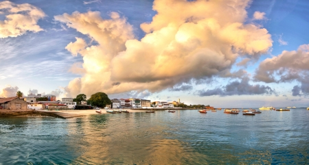 Panorama of Stone Town on Zanzibar island in Tanzania during sunrise with dramatic clouds.