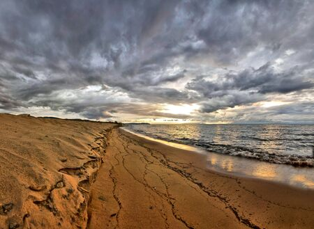 Dramatic Sunrise over Lake Malawi on beach - HDR effect photo