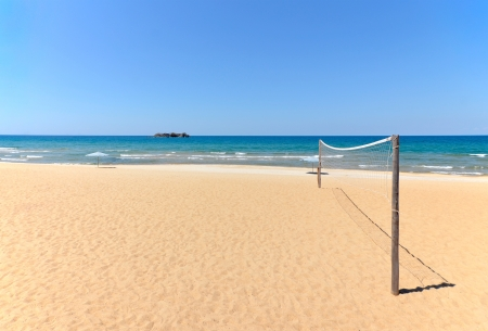 beach volleyball: Beach Volleyball net on sandy beach with sea and blue sky in the background Stock Photo