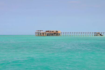 Wooden pier with turquoise sea and blue sky in tropical paradise Zanzibar Stock Photo - 16494014