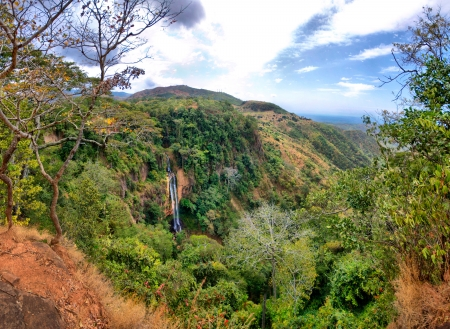 Manchewe Falls viewpoint - Long waterfall in the Jungle near Livingstonia in Malawi photo