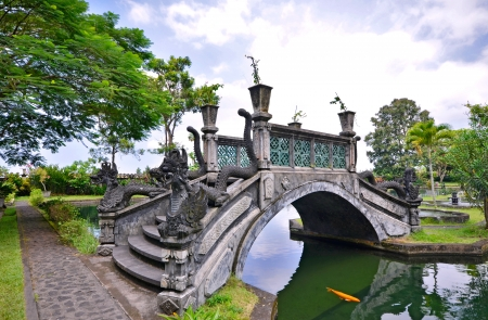 Bridge over lake at Tirtagangga Water Palace, Bali - Indonesia photo