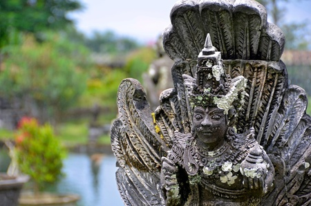 Stone sculpture at Tirtagangga Water Palace in Bali, Indonesia photo