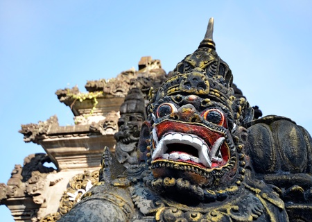 Scary stone barong mask at entrance to Tanah Lot, Bali Indonesia