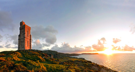 mann: Panorama of South of the Isle of Man with Milner Tower. Brada Head on the Right and Calf of Mann on the left. Tranquil scene during sunset Stock Photo