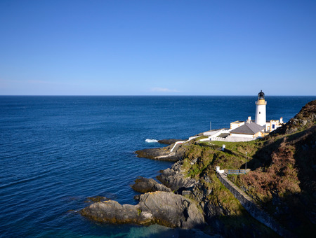 Douglas Lighthouse on the Isle of Man with sea on sunny day 스톡 콘텐츠