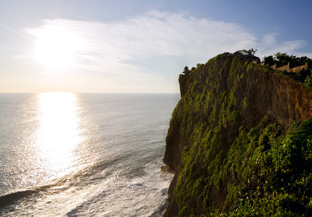 kecak: Uluwatu Temple on top of cliffs during Sunset, Bali, Indonesia Stock Photo