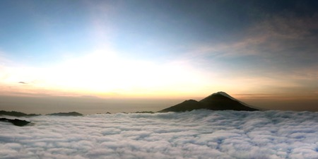 Sunrise above clouds with a mountain volcano view. Mt. Batur Bali Indonesia photo