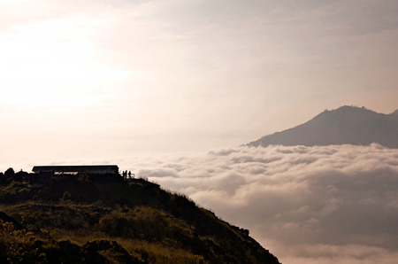 Above clouds with a mountain volcano view. Mt. Batur Bali Indonesia photo