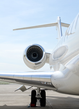 bombardier: Flying luxury private aircraft. Jet Engine with a part of a wing - Bombardier Global Express