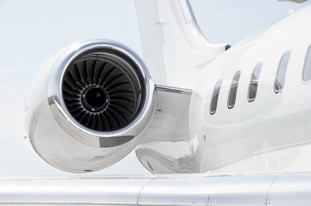 private: Jet Engine with a part of a wing on a luxury private aircraft - Bombardier Global Express