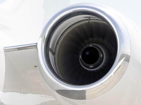 bombardier: Running Jet Engine closeup on a modern private jet airplane - Bombardier Global Express