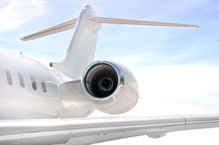 bombardier: Running Jet Engine on a modern private jet airplane with a wing  Stock Photo