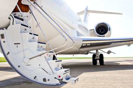private jet: Stairs with Jet Engine on a modern private jet airplane  Stock Photo