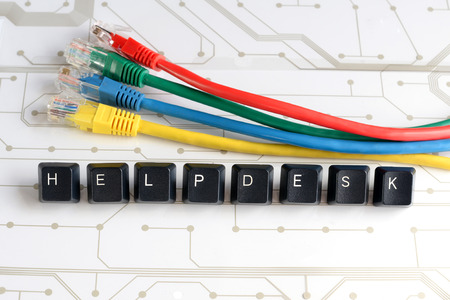 helpdesk: IT HELP, Assistance - HELPDESK made of keyboard keys with colourful network cables on white circuit board background