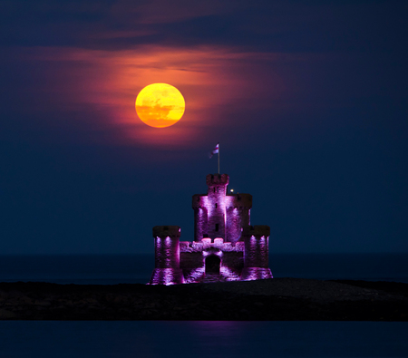 Red Blood moon rising over Tower of Refuge, Isle of Man