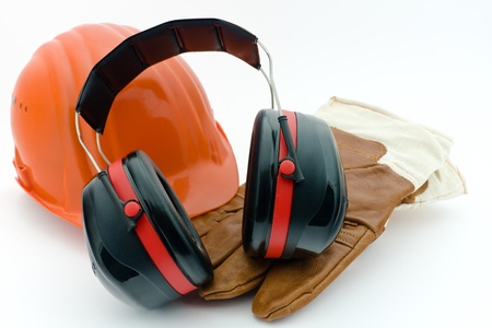 Safety helmet, hearing protection and work gloves photo