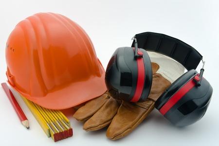 gürültü: Safety helmet, hearing protection, ruler, pencil and work gloves Stok Fotoğraf