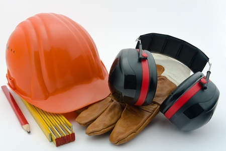 work safety: Safety helmet, hearing protection, ruler, pencil and work gloves Stock Photo