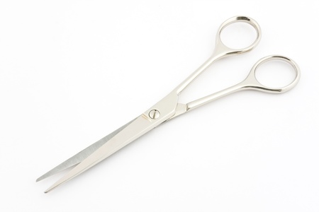 Scissors on white background
