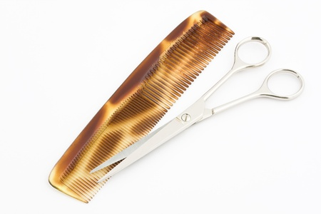 plastic comb: Comb and scissors on a white background