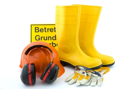 Hearing protection, work gloves, orange hard hat, safety goggles, rubber boots yellow on white background