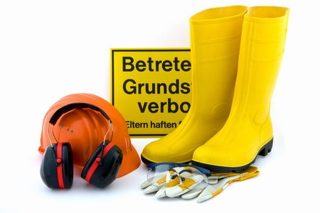 Hearing protection, work gloves, orange hard hat, safety goggles, rubber boots yellow on white background photo