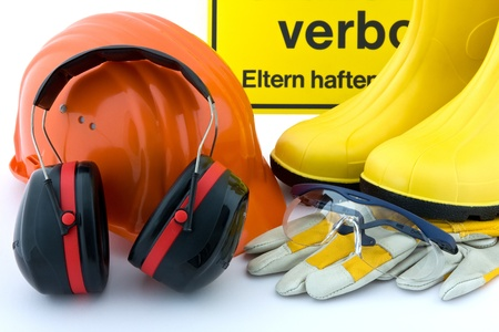 Hearing protection, work gloves, orange hard hat, safety goggles, rubber boots yellow on white background Stock Photo - 11837375