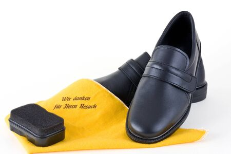 Shoes for men with cleaning cloth and sponge on a white background into. Stock Photo