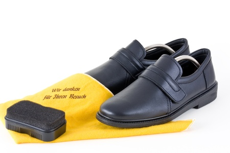Shoes for men with cleaning cloth and sponge on a white background into. photo