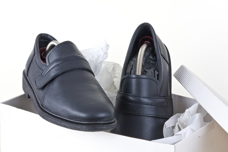 Shoes for men packed into a shoebox. photo